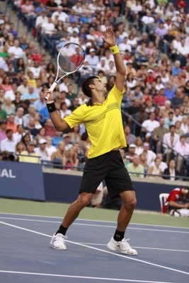 Djokovic Executing A Tennis Smash